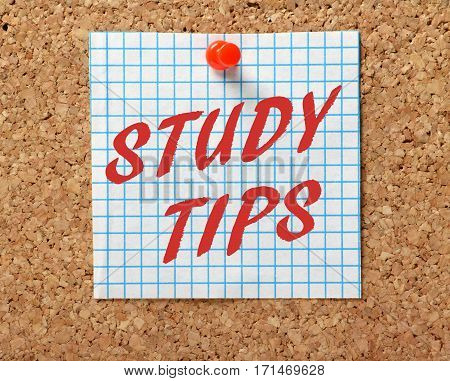 The words Study Tips in red text on a piece of graph paper pinned to a cork notice board as a reminder