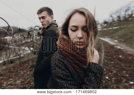 Stylish Hipster Woman And Man Posing In Windy Autumn Park. Sensual Atmospheric Moment With Space For