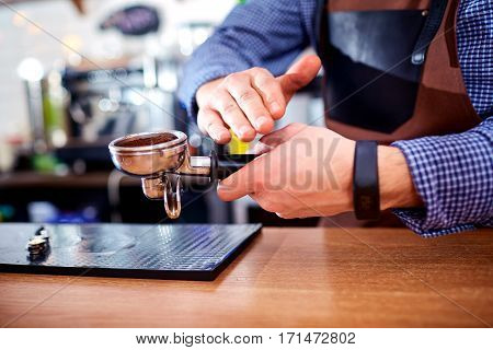 Hands bartender baristas make coffee cocoa cappuccino.
