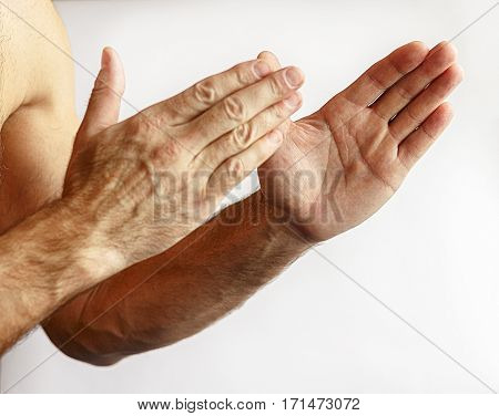 Man showing hands on a white background