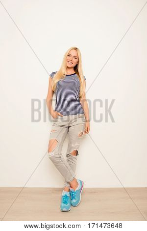 Young Pretty Stylish Woman  Posing In Ripped Jeans