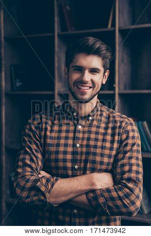 Portrait Of Handsome Smiling Man With Crossed Hands In Office