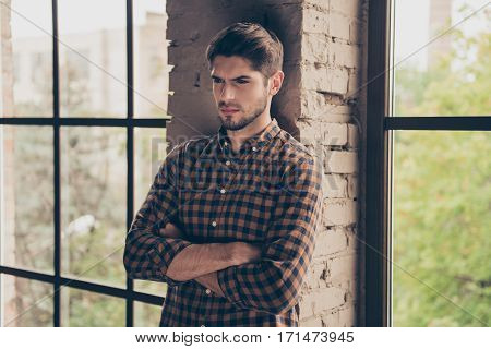 Minded Bearded Young Confident Man With Crossed Hands Near Window