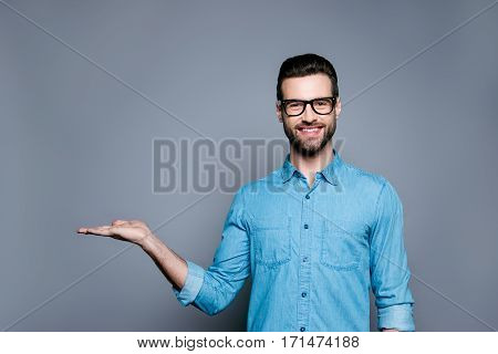 Cheerful Bearded Man In Glasses Making Advertisement Of New Product