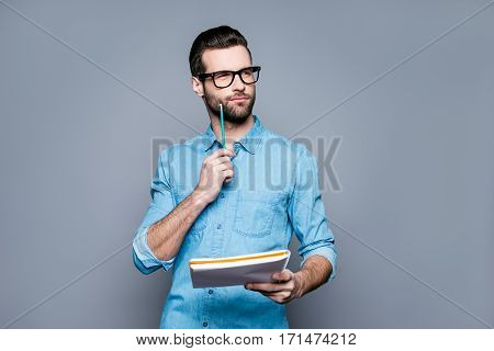 Young Thoughtful Bearded Man In Glasses Thinking About Test