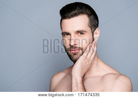 Handsome Young Man Touching His Face Before Shaving