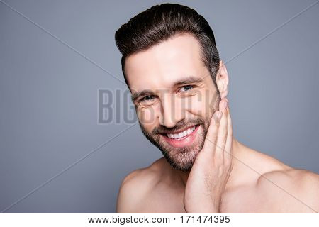 Handsome Young Smiling Man Smearing Shaving Cream On His Cheek