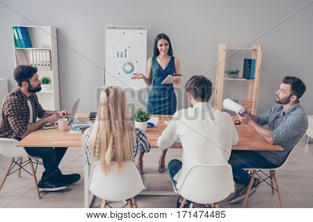 Young Woman Near Flipchart Making Presentation About Growth Of Company