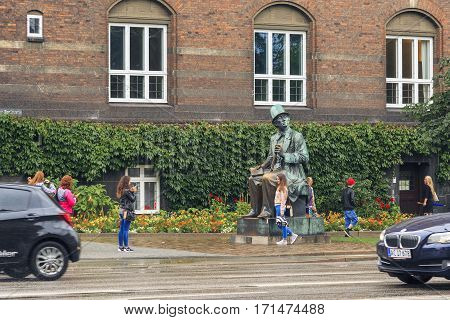 COPENHAGEN, DENMARK - JUNE 29, 2016: This is a monument to Hans Christian Andersen who enjoys the special attention of tourists.