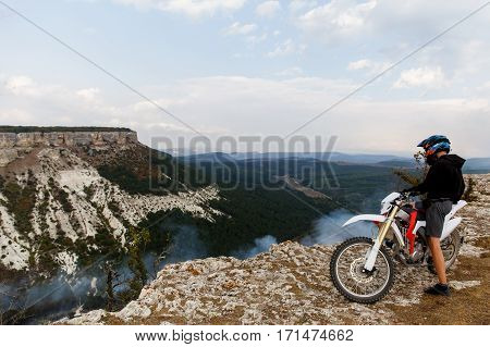 Man on bike in mountains in summer day