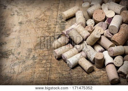 the wine corks on wooden table background