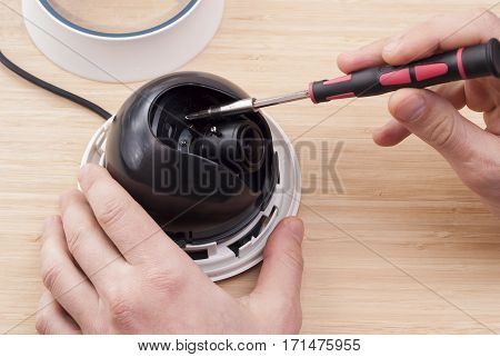 technician repairs CCTV camera on the table