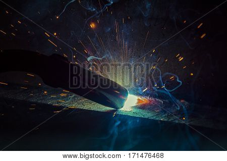 welder craftsman erecting technical steel Industrial steel welder in factory technical