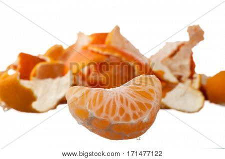 Orange, mandarin, tangerine citrus fruit and peel ion white background