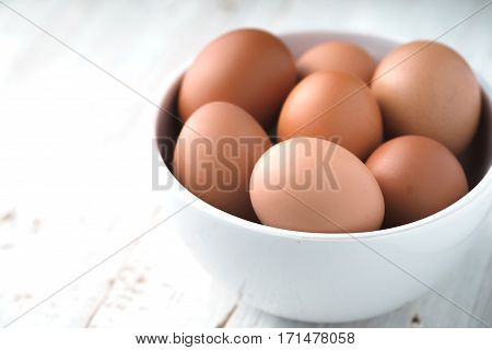 Chicken eggs in the ceramic bowl horizontal