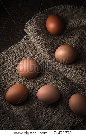 Chicken eggs on the canvas vertical table, background, vertical