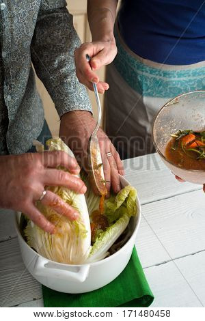 Adding marinade to the Chinese cabbage kitchen, vertical