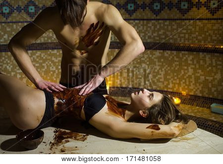 Muscular Man Makes Chocolate Massage For Sexy Woman In Salon