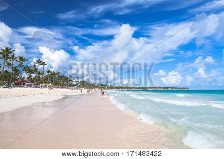 Bavaro beach Dominican republic - January 4 2017: Coastal Caribbean seascape. Atlantic ocean coast ordinary tourists rest on a sandy beach of Punta Cana resort