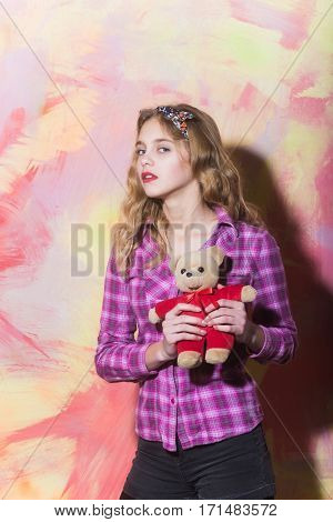 Pretty Girl With Cute Teddy Bear In Red