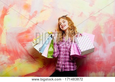 Happy Pretty Girl With Colorful Shopping Bags In Hands