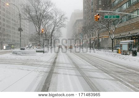 View of Broadway at 68th street during a heavy snowfall.