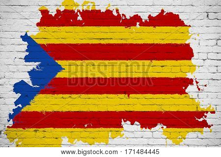 Flag Of Catalonia Yellow, Red Stripe And Star With Watercolor Splash Effect On White Brick Wall Back