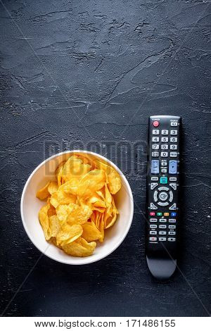 concept of watching movies with chips top view on dark background