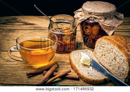 Continental breakfast with toast bread, butter, orange jam and tea