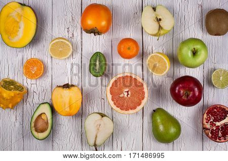 Studio shot of tropical fruits on a white wooden board in a checkerboard pattern. Healthy lifestyle concept