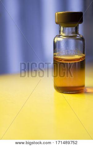 Transparent vial with liquid medicine. No people