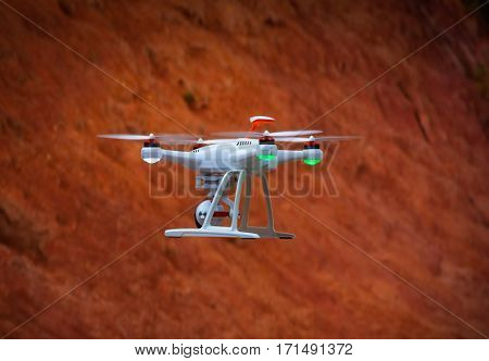 drone flying with a orange background from the hill