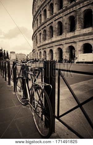 Street view with bicycle and Colosseum in Rome, Italy.