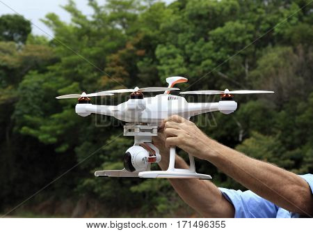 a man holding a drone ready for flight