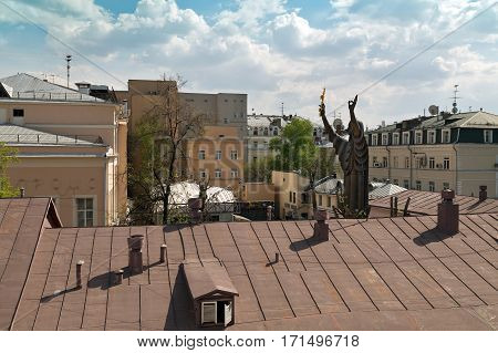 MOSCOW/ RUSSIA - APRIL 30. Aerial view of the huge sculpture of a praying woman and buildings around Petrovka-Street in Moscow, Russia.
