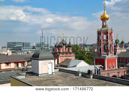 Panoramic view of the high Monastery of St Peter and a new shopping center. Moscow Russia.