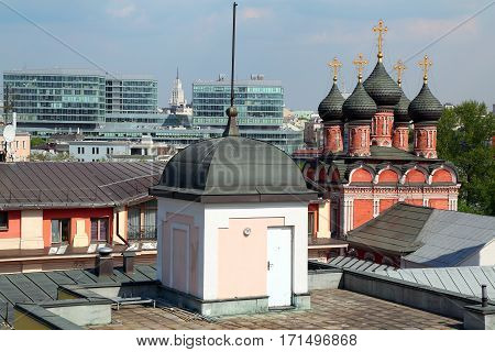 Aerial view of the high Monastery of St Peter and a new shopping center. Moscow Russia.
