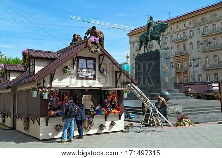 MOSCOW/ RUSSIA - MAY 8. The workers decorate a shopping kiosk for the annual spring market on Tverskaya square near the monument to Yuri Dolgorukiy on May 8, 2014. Moscow Russia.