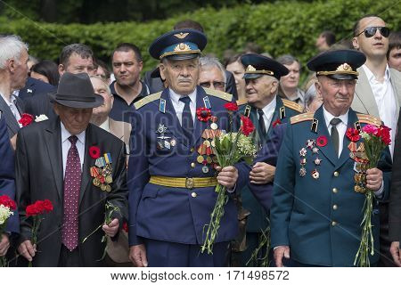 Kiev Ukraine - May 09 2016: World War II veterans laid flowers at the grave of the Unknown Soldier in the Park of Eternal Glory