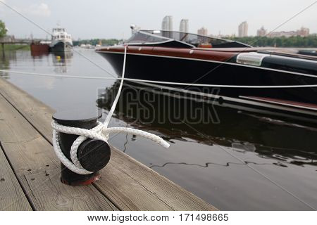 Motor boat and mooring rope closeup. Transport