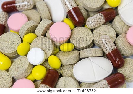 a set of tablets and pills for a speedy recovery and prevention of diseases. Medical background
