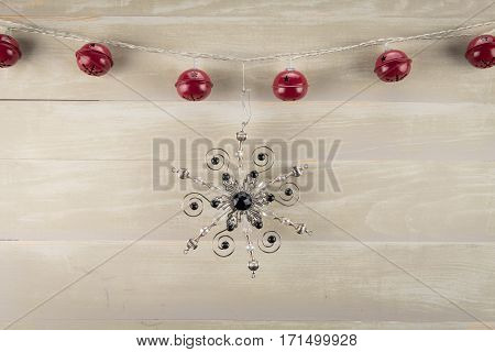 Jingle Bells with Ornate Snowflake against neutral background