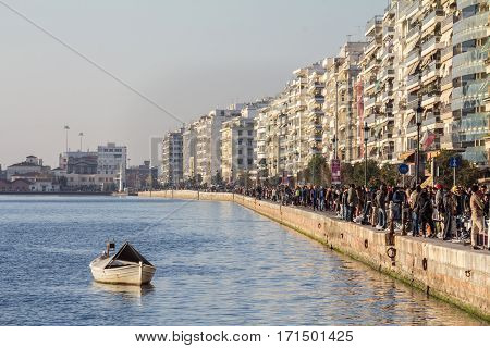 THESSALONIKI GREECE - DECEMBER 26 2015: Thessaloniki seafront (Victory avenue aka Nikis) seen in winter a heavy crowd on the quay