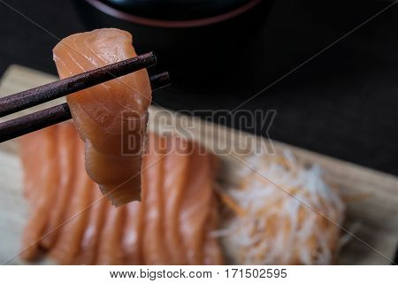 Closeup Chopsticks Raw Salmon Sashimi