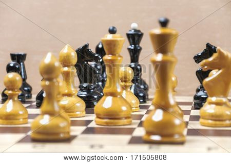 The chess pieces are placed on the chessboard. Placement during the game. Focus on white pawn
