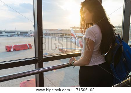 Young Girl In Airport Lounge Looking In Window Plane Waiting Departure Happy Smile Woman Flight Delay