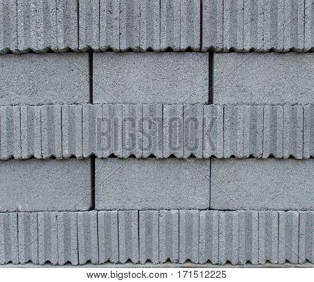 many grey concrete blocks overlay on pallet