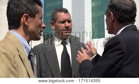 Executive Talking To Staff and Wearing Business Suits