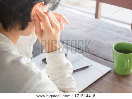 Woman wear headphones surfing the net by smart phone stock photo
