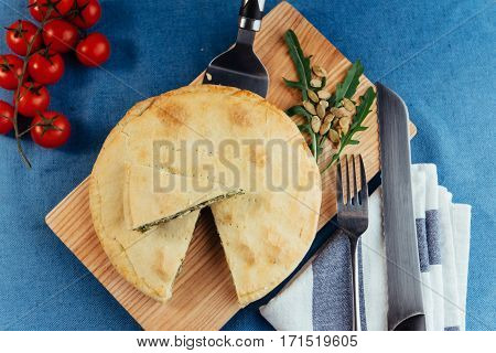 Traditional Greek spinach pie with puff pastry.